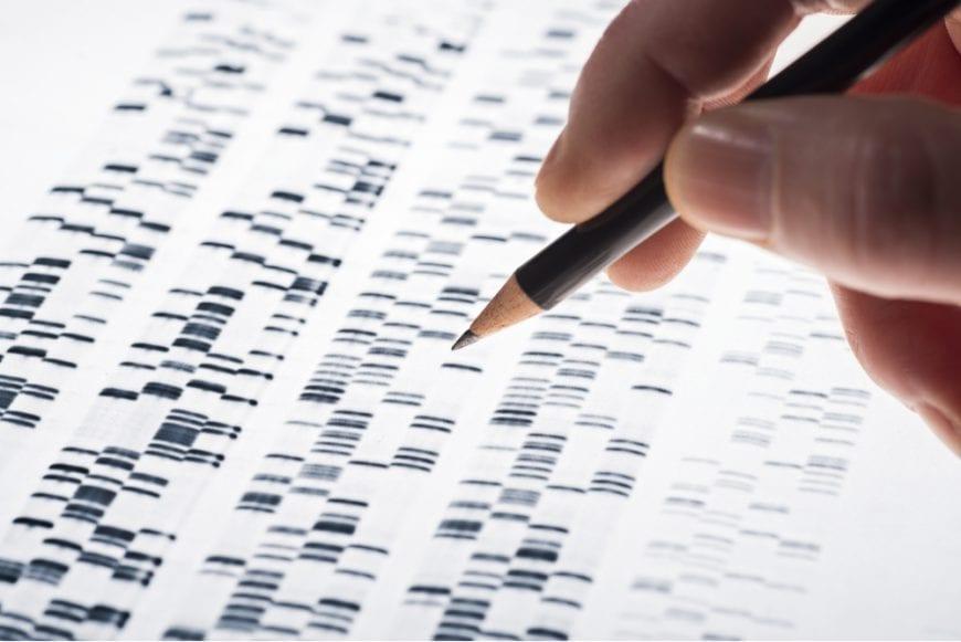 Hand working on DNA codes