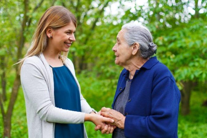 Granddaughter Walking with Parkinsons Grandma