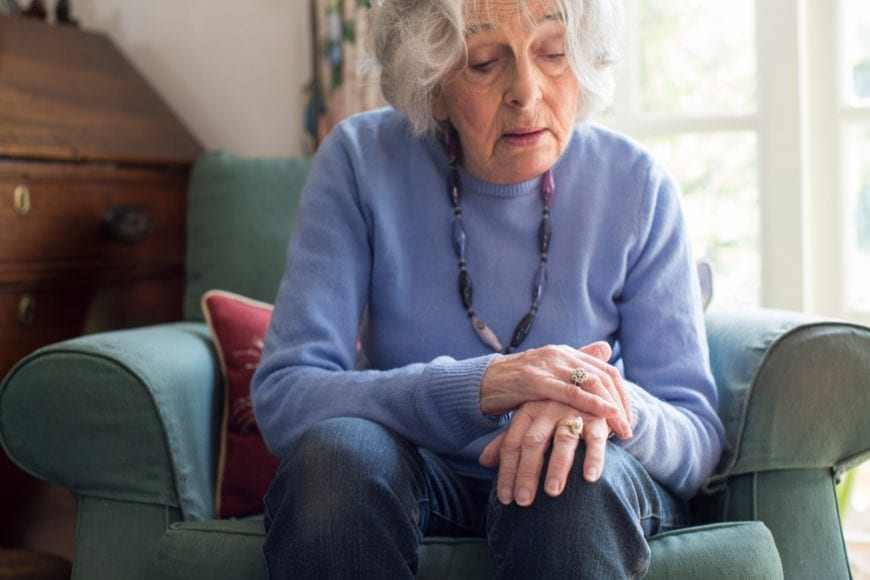 Older adult Sitting with Parkinson's