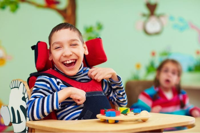 child with cerebral palsy laughing