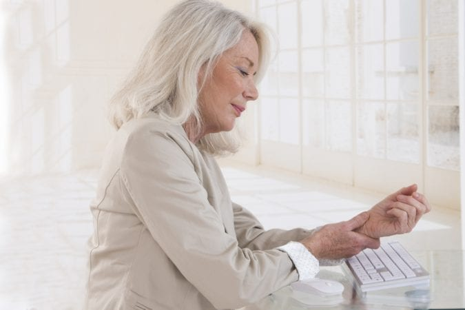 older woman perhaps thinking about whether she needs CBD or THC for pain relief
