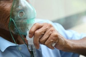 COPD man with oxygen mask on close up