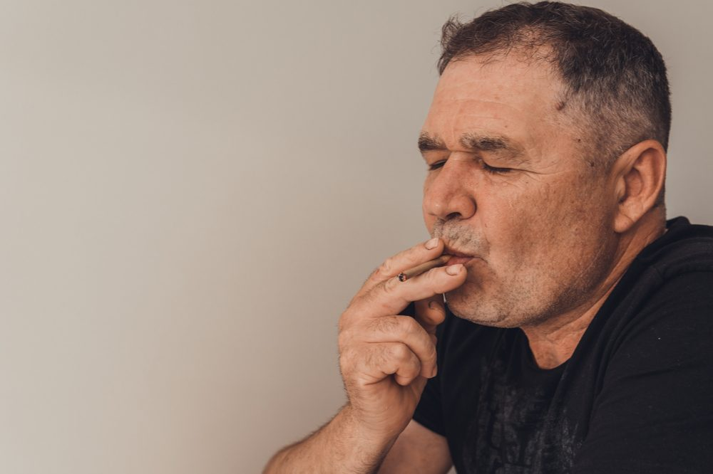 liver pain represented by oldewr white man who may be smoking cannabis for it