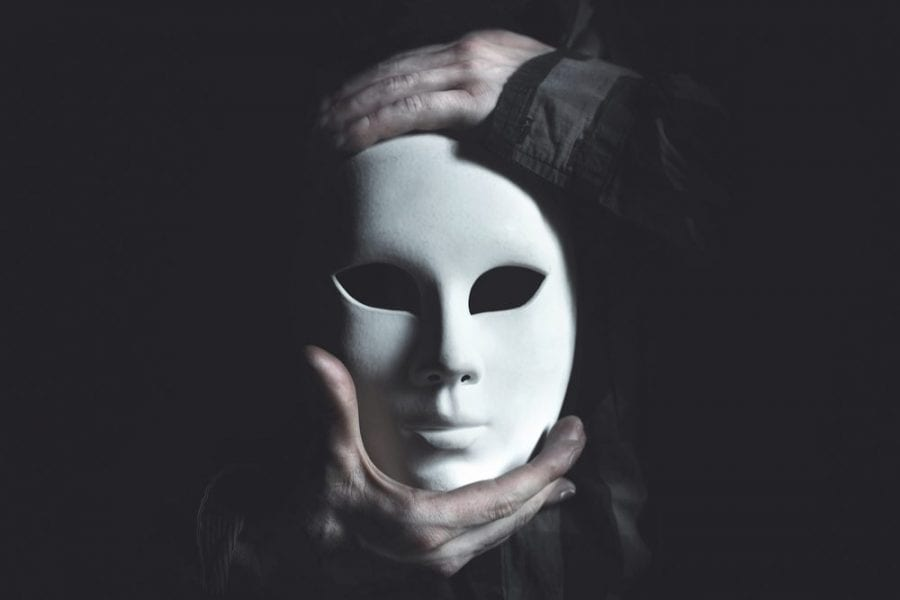 Dissociative Identity Disorder represented by scary mask