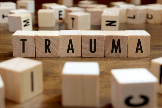 Trauma spelled with wooden blocks
