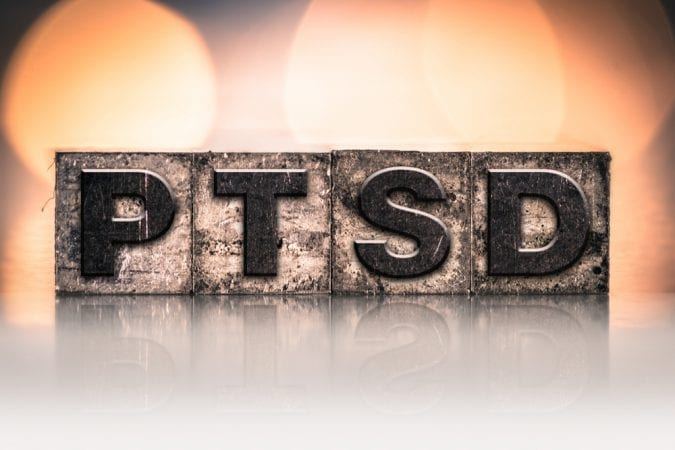 PTSD spelled in distressed wood boxes