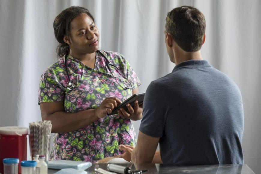 Nurse taking patient history