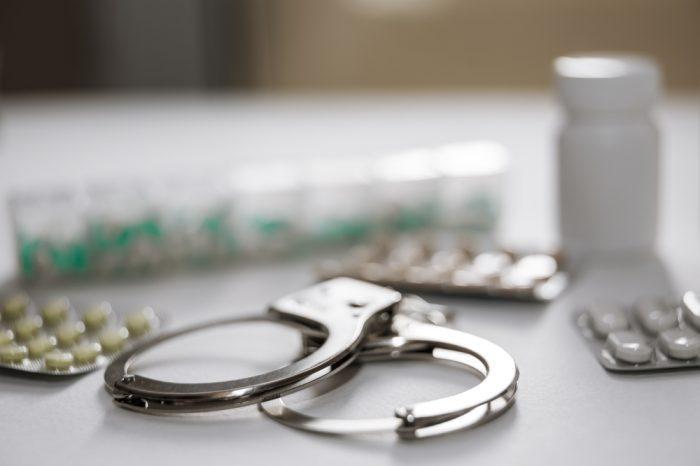 handcuffs and pills