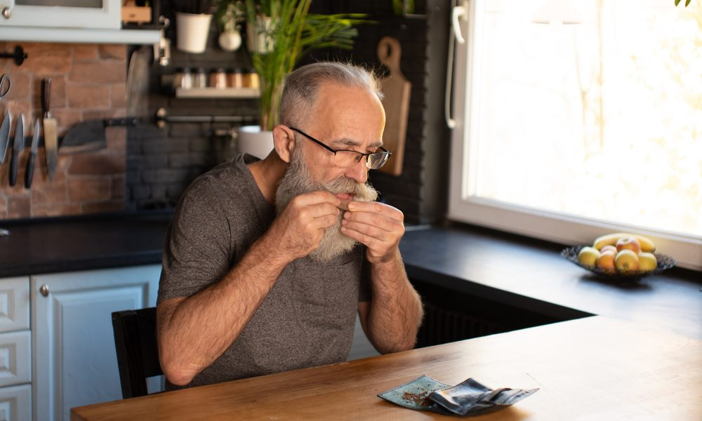 how to treat dementia represented by elderly man rolling a joint