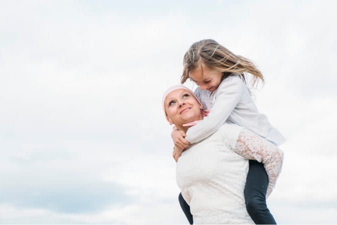 cancer patient mom playing with daughter