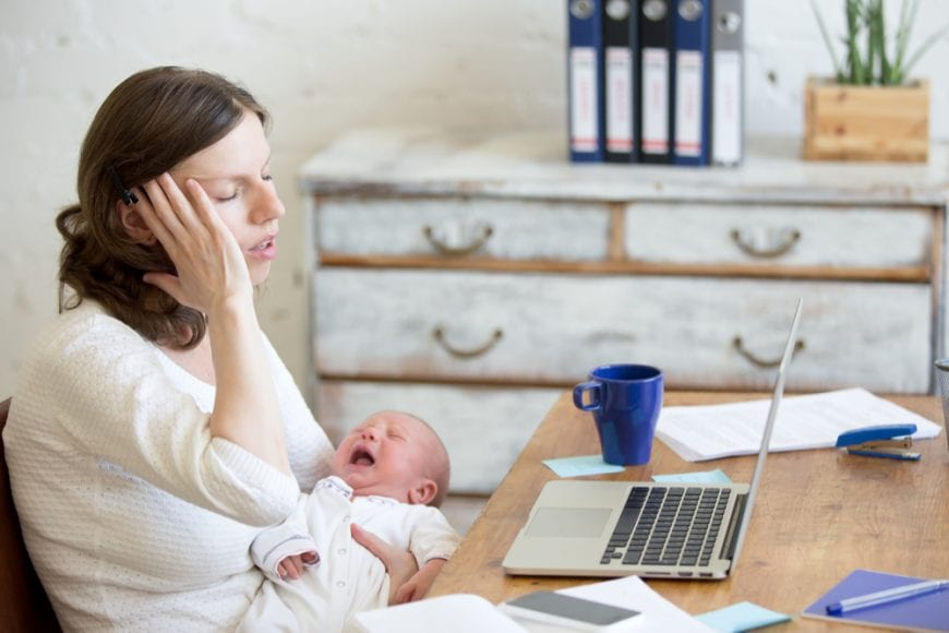 New mom sitting at table overwhelmed