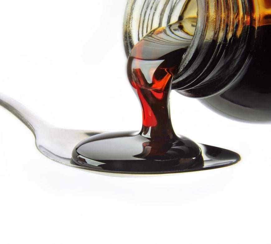 Close up Cough Syrup Poured Onto Spoon, drugs