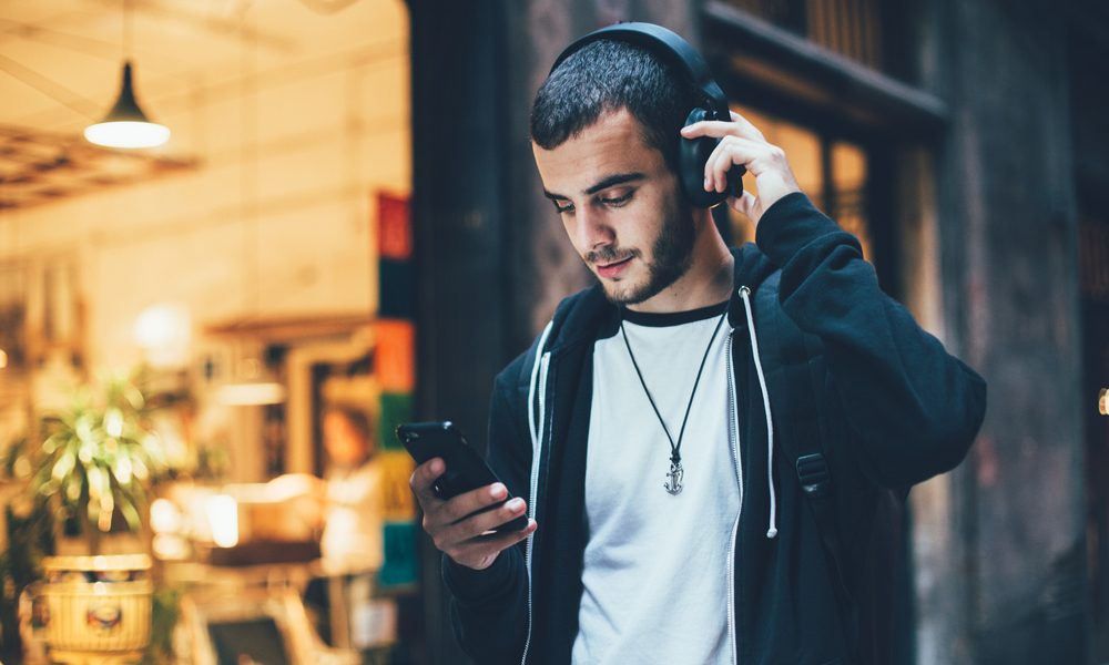 tic disorders represented by young male teen walking with headphones on