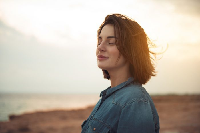 woman breathing deep and relaxing