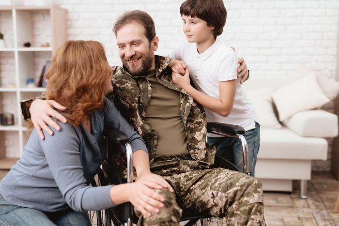 vet with his wife and son