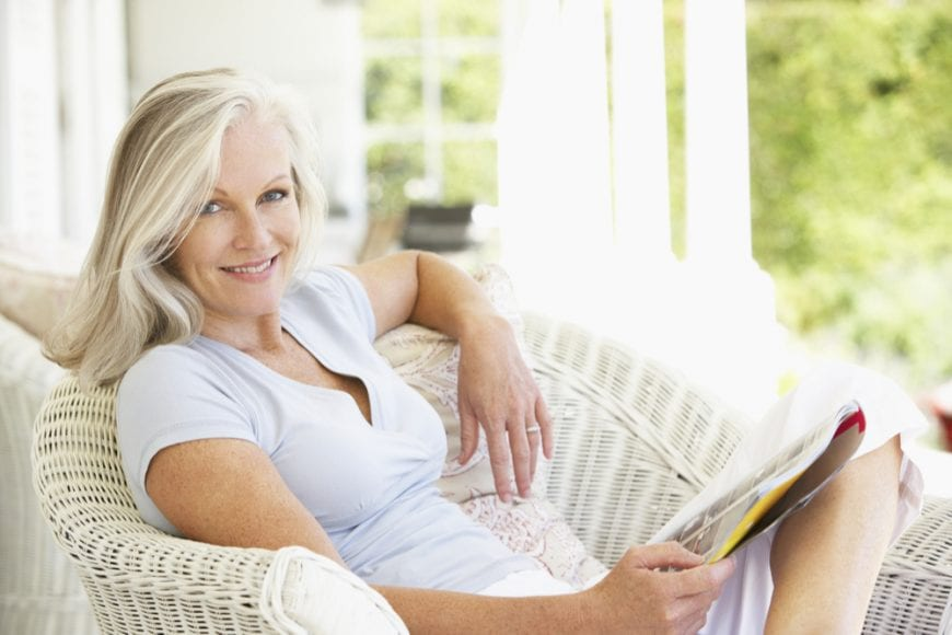 Older Happy Woman Relaxing on Her Porch