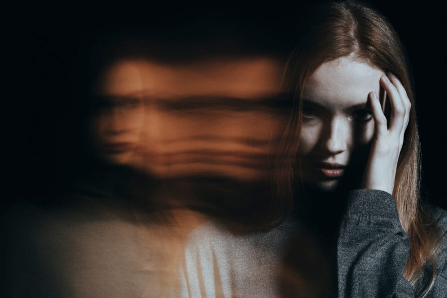 Psychosis Young Girl with hallucinations blurred in the background