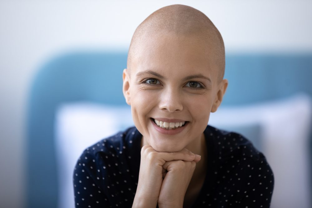 smiling young female cancer patient showing coping due to THC in cannabis