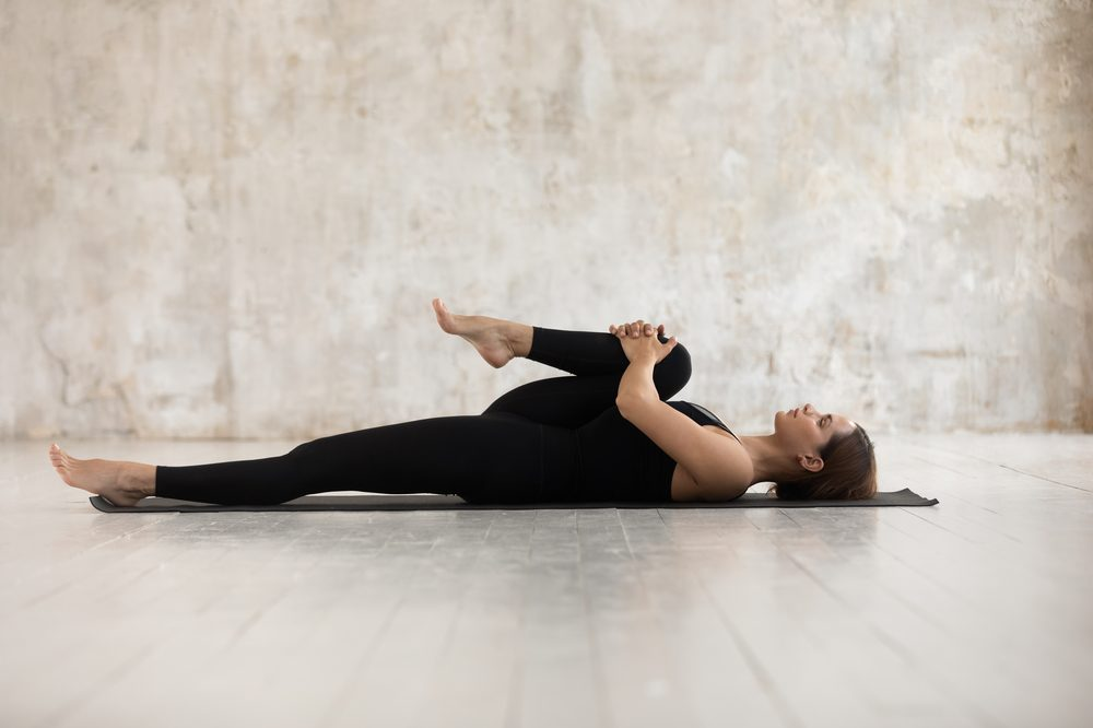Young woman doing yoga to represent living pain free from THC in cannabis
