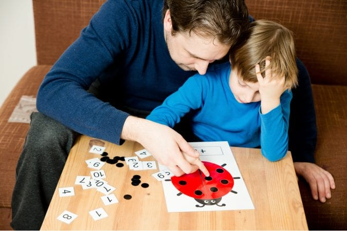 Dad teaching boy with autism