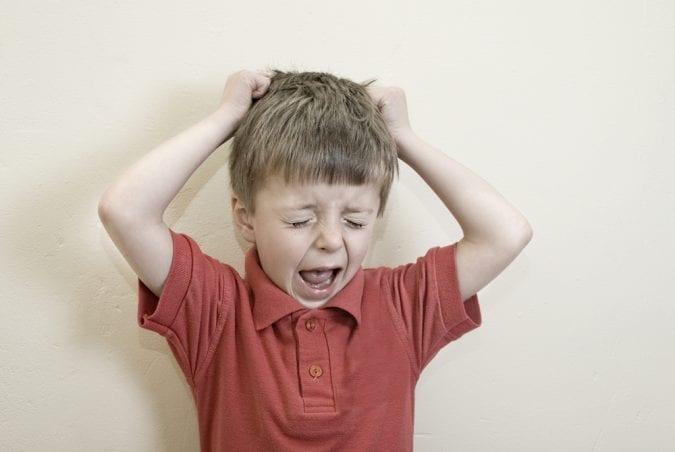 Boy with Autism having challenging behavior