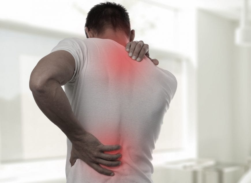 Man holding 2 points of pain on his back