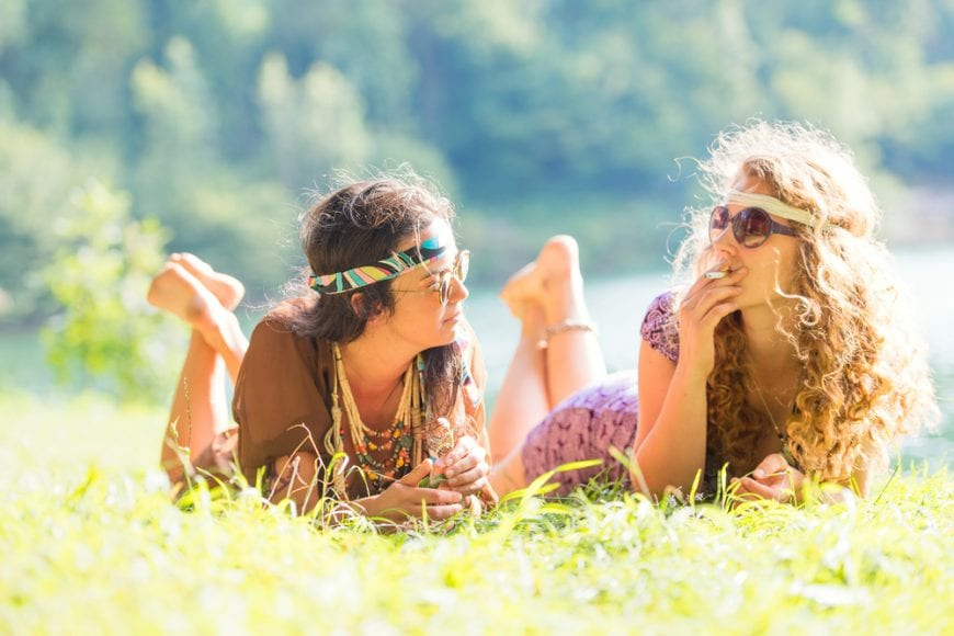 hippie girls smoking a joint, like at woodstock