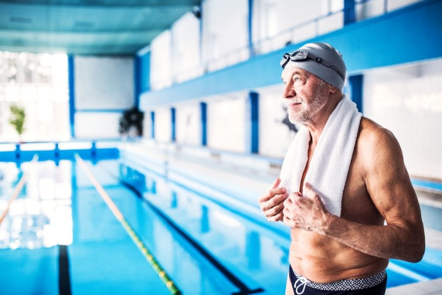 Senior man at a swimming pool