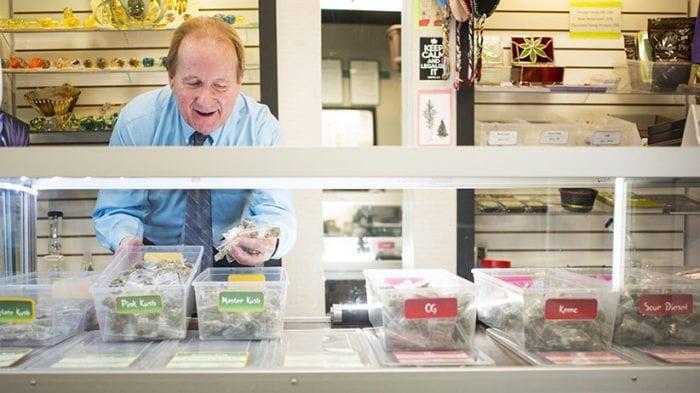 police raid dispensaries man setting up edibles
