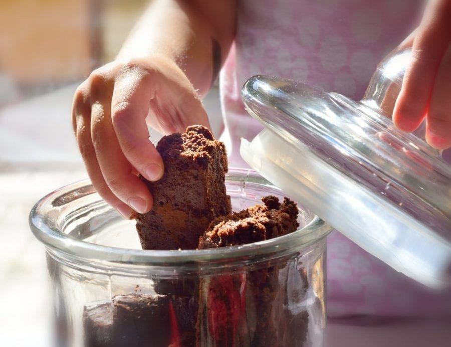 child taking a brownie for a marijuana overdose risk