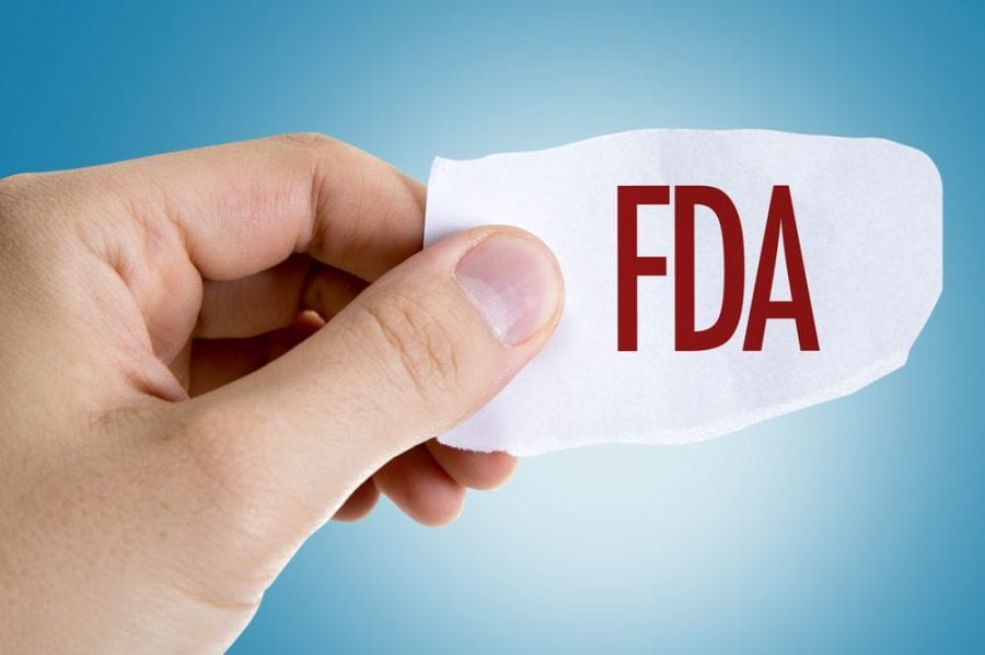 FDA Approval slip of paper being held up by hand