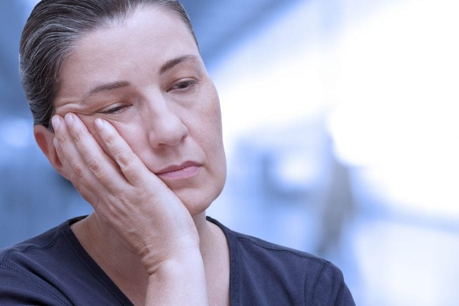 middle aged woman in chronic pain from fibromyalgia