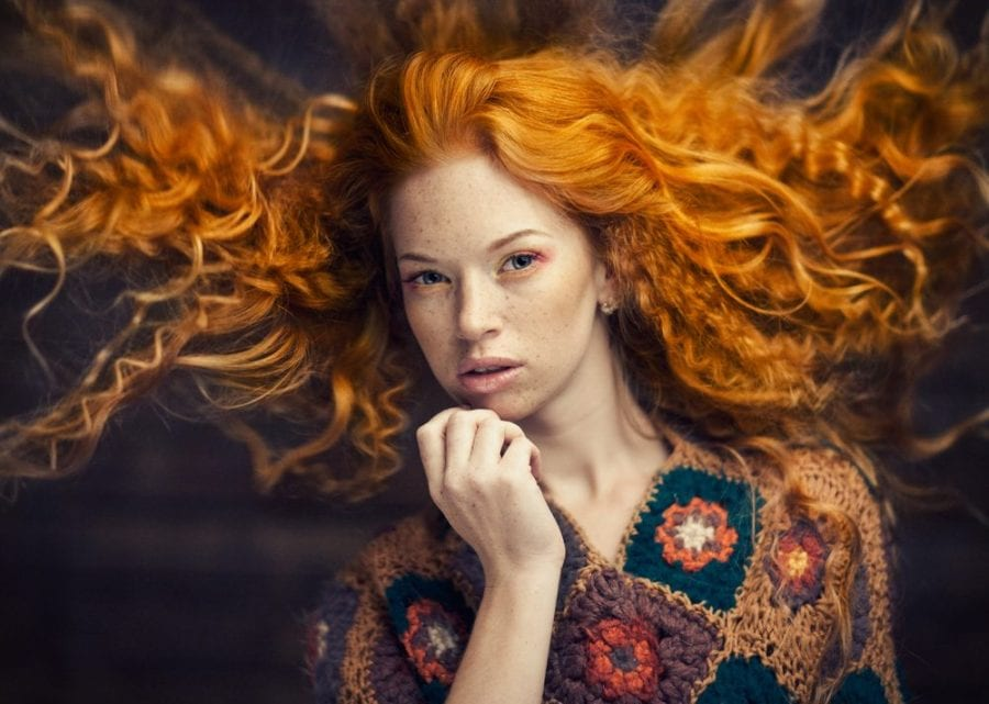beautiful redhead with hair blowing
