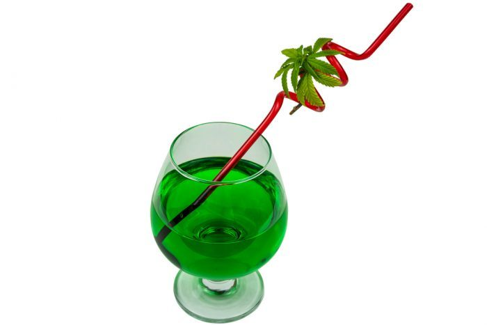 green cannabis drink with curly straw