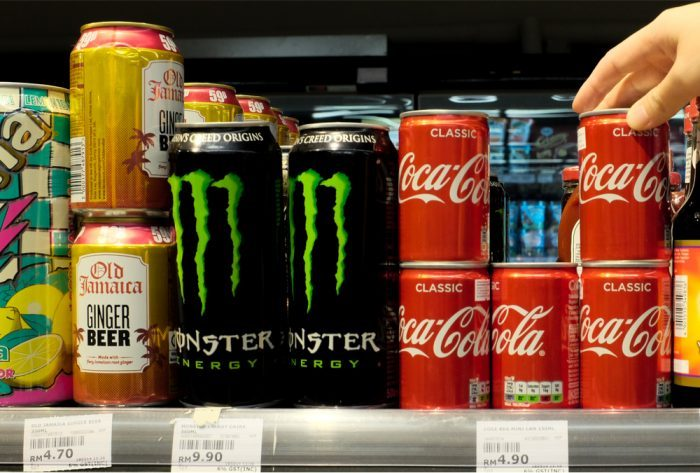Monster Energy Drinks and Coca-Cola Side by side on a store shelf