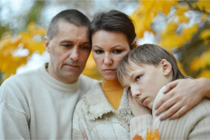 sad family of three without access to cannabis medicine