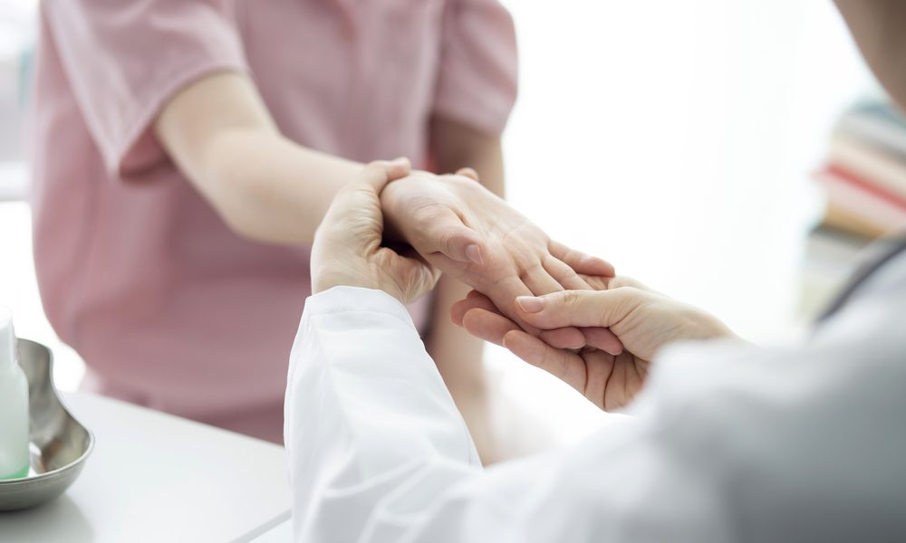 medical cannabis for arthritis represented by a physician examining the hands of a patient