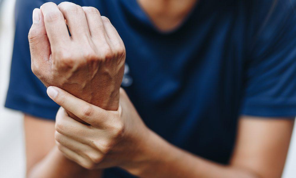 medical cannabis for arthritis represented by man grabbing his wrist