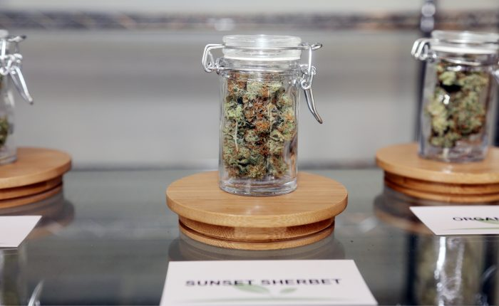 glass container of cannabis bud