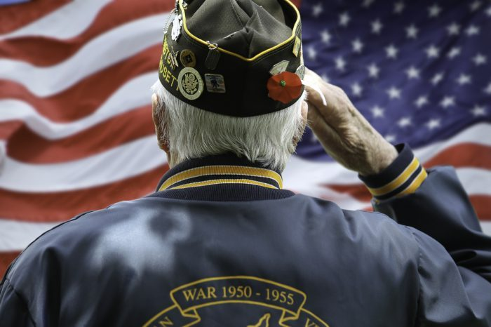 veteran salutes the flag