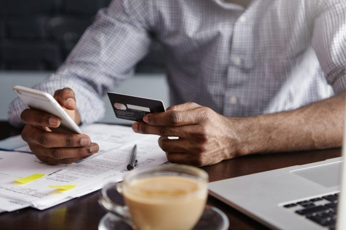 man banking digitally