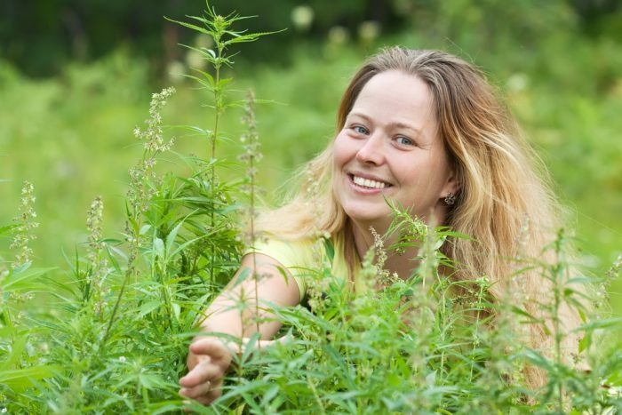 woman in front of hemp plants