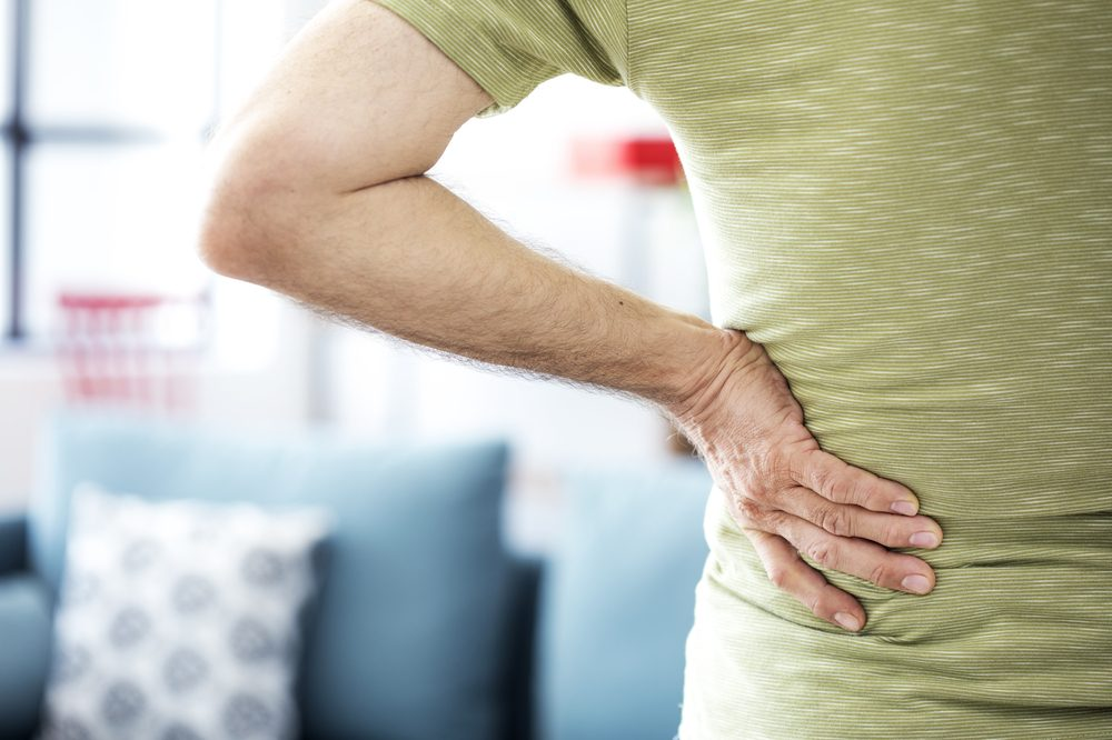 person with intervertebral disc pain