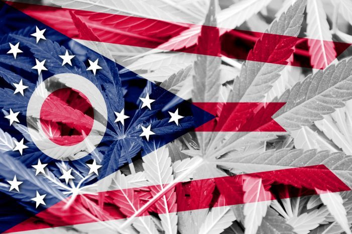 ohio flag imposed over cannabis leaves