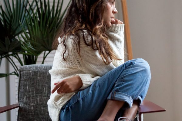 teen anxiety girl chewing nails while sitting in chair