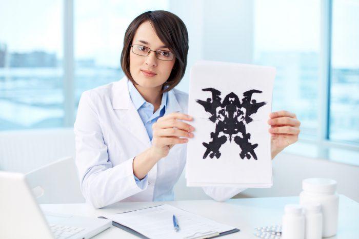 a psychologist studies ink blots