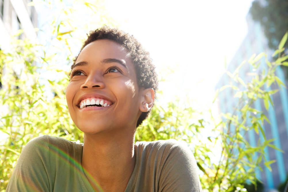 woman happy possibly because she uses cannabis to combat the biological causes of anxiety