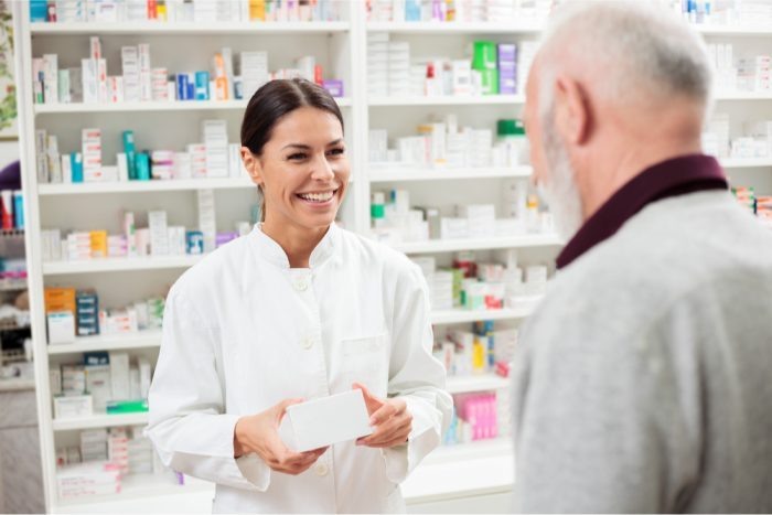 a potential cannabis pharmacist at work chattign with an older man