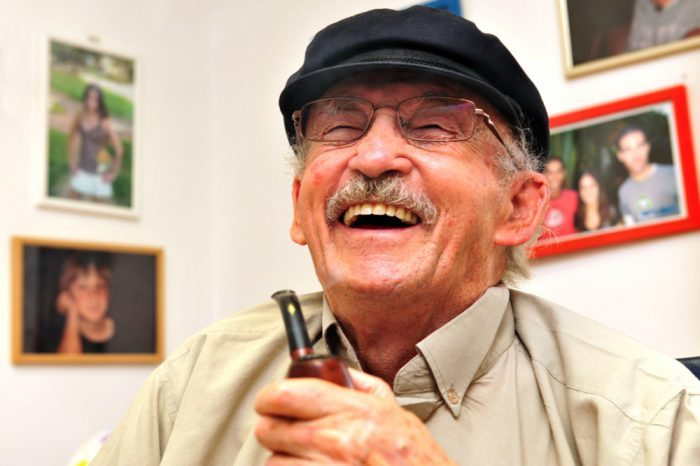 geriatric medicine smoked out of a tobacco pipe helps this older fellow to laugh