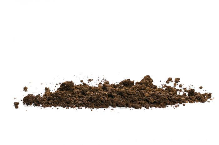 large pile of dirt on white background